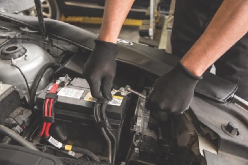 Replacing dead car battery.