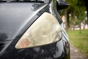 Dirty car headlights in need of headlight lenses restoration services.